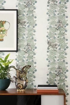 This charming Acacia Wallpaper forms part of Cole & Son's Ardmore Collection. It features playful monkeys perched amongst the large leaves of the Acacia tree. Available in a choice of 5 colours each designed to create a wide striped effect. Cole And Son Wallpaper, Green Wallpaper, Wallpaper Ideas, Acacia, Cole Son, Monkey Wallpaper, African Tree, South African Design, African Traditions