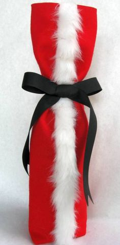wine bottle cover...great idea for our wine group at the holidays instead of the brown paper bag