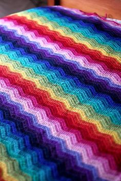 The pattern that I've been following is this Neat Ripple Pattern from Attic24 (awesome blog - check it out). She has fantastic instructions that even a newbie hooker like me can follow.