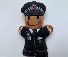 The newest addition to my collection #heddlu #police #policeman #policeofficer #wales #welsh #trolleydolliedesigns Birthday Present For Husband, Husband Birthday, Birthday Presents, Gingerbread Man, Police Officer, Welsh, Letterbox Gifts, Work Gifts, Retirement