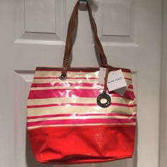 """Nine West One Stop Shopper Tote NEW Cheery tote goes right from the office or school to the beach. Lots of compartments inside with bonus cosmetics pouch. Measures approx 12"""" high x 16"""" across x 5"""" deep. Unworn with tags attached. Sorry no trades or PayPal. Thanks for shopping by! Nine West Bags Totes"""
