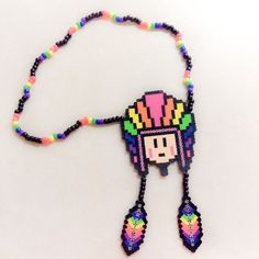 Hey, I found this really awesome Etsy listing at https://www.etsy.com/listing/196185835/rainbow-plur-warrior-with-feathers-kandi