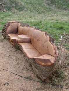 A Carved Log Garden Bench