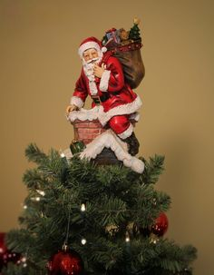 "11"" UNIQUE Santa in Chimney tree topper. Jolly Ole' Saint Nick delivering gifts to all. 11.0""H x 5.0""L x 5.5""W. Resin. Shipped along with The Shepherd's Staff™ for easy installation. Designed for arti"