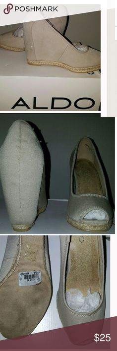"""Aldo espadrilles size 7 Excellent condition, well cared for, normal wear to bottom of soles. Tan canvas, peep toe. Size 7.  Hell is 4"""". Open to offers, please use offer button white dot on pic one was a piece of lint didn't see it until after I snapped pic. It's not on shoe any longer. ALDO Shoes Espadrilles"""