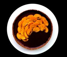 Truffle chocolate tart with blue cheese and Cointreau to the sugar dough with cocoa and almonds + persimmon (November-April)