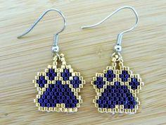 Items similar to LSU Tigers purple gold paw print beaded earrings on Etsy Beaded Earrings Patterns, Seed Bead Patterns, Bracelet Patterns, Beaded Bracelets, Seed Bead Jewelry, Seed Bead Earrings, Hoop Earrings, Brick Stitch Earrings, Animal Earrings