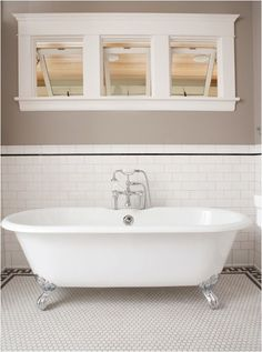 Classic Subway Tile Bathtub Surround - traditional - bathroom - minneapolis - Clay Squared to Infinity. The grey/black line near the top of the subway tile finishes it neatly. Also, love the casings around the window. Bathtub Tile, Bathroom Floor Tiles, Tiled Bathrooms, Clawfoot Tubs, Freestanding Bathtub, Kitchen Floor, Kitchen Backsplash, White Subway Tile Bathroom, Subway Tiles