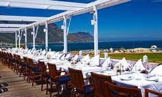 Situated on the Clifton coastline, The Bungalow in Cape Town is a hotspot for dining and drinking. In summer, Bungalow Restaurant is ideal for dining outside. Cape Town, Bungalow Camping, Clifton Beach, See Picture, Nice View, Summer Beach, Outdoor Spaces, Places Ive Been, South Africa