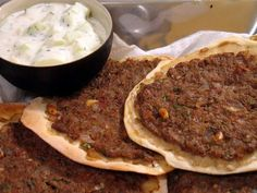 """This evening Lisa successfully tackled an all-time favorite dish, lahmajoun (also, lahm bi ajeen, s'fiha).  These little flatbread """"pizzas"""" feature a crispy crust and ground beef mixed with tomatoes and a delicious mix of various herbs and spices. ..."""