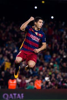 Luis Suarez of FC Barcelona celebrates after scoring his team's fourth goal during the La Liga match between FC Barcelona and Sporting Gijon at Camp...