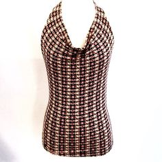 """Vintage Nautical Stretch Halter Top True late 90's vintage black halter with muted nautical inspired chain link print. Low cut cowl neckline. Incredibly stretchy, slinky and form fitting! By Mine USA. Size Medium. 90% polyester 10% spandex. Chest measures 32-44"""". Length 23"""".  Good pre-owned condition with no holes, rips, or stains.  KWs: 00's, printed, stretch, retro, indie, blogger, urban Vintage Tops Tank Tops"""
