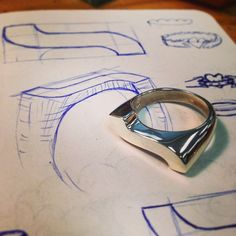 Sterling silver hand crafted signet ring with sketch by Benjamin Black Goldsmiths.