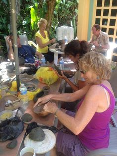 Creating Taino claywork reproductions...  relaxing at Virgin Kayaks, North Shore, St. Croix, USVI