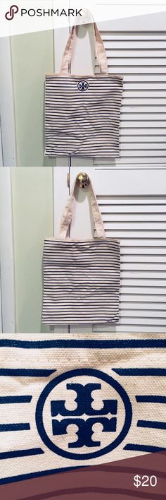 Tory Burch Canvas Tote Navy and ivory striped canvas tote. Perfect condition, never used. Authentic. Tory Burch Bags Totes