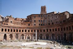 Market of Trajan. The market was a center of Roman life. Roman architecture utilizes arches and columns and is it's signature.