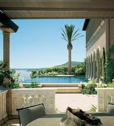 Great idea for Mediterranean columns/pool Cher-Swimming with the Stars: 12 Celebrities' Cool Pools