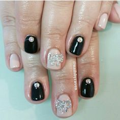 Gel manicure with Swarovski crystals and crystal bows