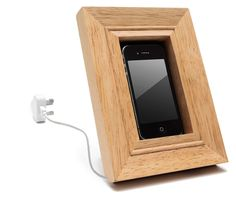 frame mobile phone holder  frame your phone while it charges. simply feed your charging cable through the frame.    - cleverly designed to suit all phones & chargers  - table top or wall mounted (fittings not supplied)