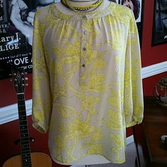 Summery Banana Republic Blouse Perfect for the summer!  Beautiful Banana Republic Blouse with silver buttons on the front and button detail on the 3/4 sleeves.  Super cute and in great condition!  The material is 100% polyester.  Size medium. Banana Republic Tops Blouses