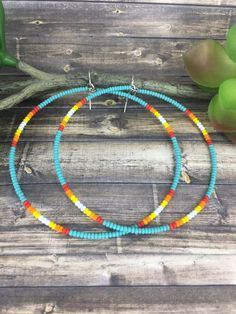 Thank you for checking out this Beading Night Owl listing. These are carefully handcrafted extra-large hoop earrings. I hand cut each hoop for an exact circular shape. Each bead is added one at a time to create this harmonious pattern. They are made with size 11/O glass seed beads,