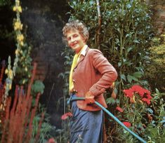 Nancy Lancaster in her garden at Haseley Court
