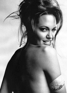 Angelina Jolie by Mario Testino - woman who is marked and scarred and not ashamed of her past. She still chooses to see hope and truth in life. As beautiful and delicious as her exterior is to the world, Angie has as tremendous warm heart and a good soul. Angelina Jolie Fotos, Brad And Angelina, Angelina Jolie Photoshoot, Mario Testino, Most Beautiful Eyes, Beautiful People, Absolutely Gorgeous, Jolie Pitt, Portraits
