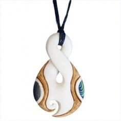 Bone Twist Pendant with Paua Shell The New Zealand twist represents the intertwined paths of two people forever. This bone pendant is stylishly tea stained and features New Zealand paua shell highlights. Singles Twist, Maori Designs, Paua Shell, Tea Stains, Bone Carving, Pendant Design, New Zealand, Washer Necklace, Bones