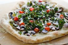 Pizza with Mushrooms, Goat Cheese, Tomatoes and Kale (Via Knitty Baker)