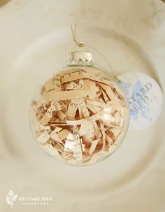 Simple Vintage Sheet Music Ball Ornaments using old sheet music and clear plastic ball ornaments.