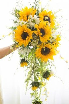 Cascading Bouquet designed with Oncidium orchids, sunflowers and greenery. Designed by CS Events and Floral. Cascading Bouquet designed with Oncidium orchids, sunflowers and greenery. Designed by CS Events and Floral. Bouquet En Cascade, Rose Bouquet, Trailing Bouquet, Boquet, Burgundy Wedding, Fall Wedding, Wedding Ideas, Trendy Wedding, Wedding Inspiration