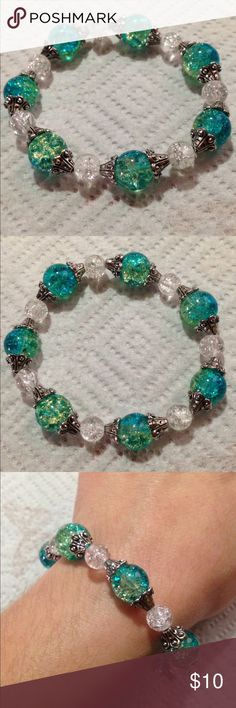 """Blue and Green and White Sparkly Glass Bracelet This pretty bracelet is made with sparkling blue and green and white glass beads. It measures 8"""" in circumference. This piece is elastic and will stretch to fit. All PeaceFrog jewelry items are made by me! Take a look through my boutique for coordinating pieces and more unique creations. PeaceFrog Jewelry Bracelets"""