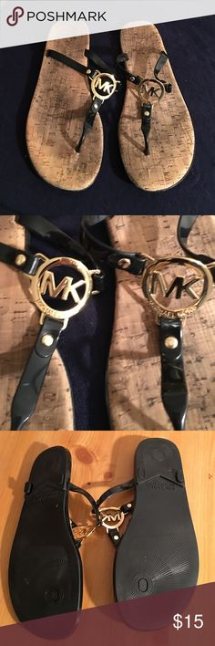 MICHAEL KORS LOGO THONG SANDALS SIZE 10 PREOWNED WORN GOOD CONDITION MICHAEL KORS THONG SANDALS. GOLD MK LOGO. BLACK PATENT LEATHER STRAPS MICHAEL KORS Shoes Sandals