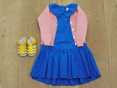 Pink Cashmere Cardigan, from £55  BubbleChops Exclusive Blue drop waist dress, £65 Handmade Yellow Leather Sandals, £55