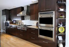 Stainless steel appliances with dark cabinetry
