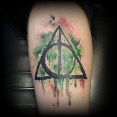Deathly Hallows Watercolor tattoo by Haylo! www.luckybambootattoo.com