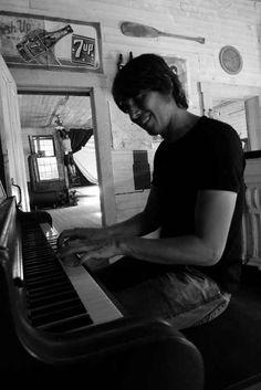 Professor Brian Cox playing piano on location