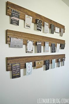 Like this - but hang different size frames instead of using cables and loose paper lizmarieblog.com - photo display