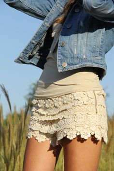 jean jacket over beige tank w/ beige crochet layered shorts.