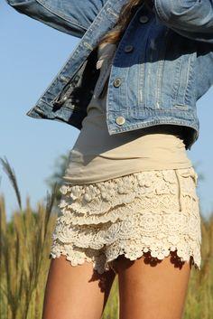 jean jacket over beige tank w/ beige crochet layered shorts.