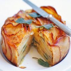 Cheese, Onion and Potato Pie , Serves: 4-6 Serving, Directions: 1. Heat butter in a frypan over a medium heat and fry onion until it becomes soft and translucent. Preheat oven to 200°C. Lightly grease an 18cm x 7cm springform tin and press an overlapping layer of potato slices around sides. Next, create a layer of concentric rings of overlapping discs to cover base. Spread a little onion and cheese across base, season with sea salt and ground black pepper, then dot with 4 sage leaves. Cover…