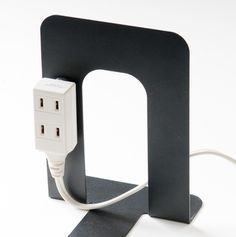 Use a magnet to attach an extension cord to a metal bookend. This would come in handy for any light-up displays on the shelves. Just conceal behind books, etc. Cord Organization, Home Management, Diy Interior, Smart Home, Clean House, Fashion Background, Storage Spaces, Living Room Designs, Office Storage