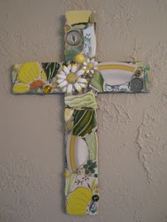 Mosaic cross with daisies in green and yellow, mosaic art.