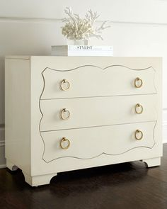 "Chest made of maple veneers with an alabaster finish. Three decoratively shaped drawers with ring pulls. Adjustable glides. 38""W x 18""D x 30""T. Imported. Boxed weight, approximately 131 lbs."