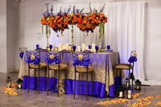Bright purple and orange table setting by Perfect Petals