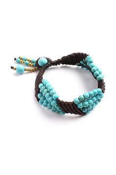 This handmade creation evokes a boho chic look with the design of this bracelet. Braided the dark brown bracelet by hand with macrame techniques, expertly adding turquoise colored dyed calcite and bra