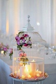 Use flowers and candles to transform the cage!
