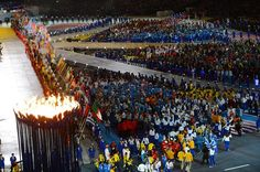 Stunning send off: Athletes enter the stadium, passing by the Olympic cauldron, during the Closing Ceremony of the London 2012 Games