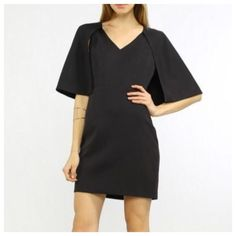 """🍾 HP 4/5 🍾 Black Mini Capelet Dress 100% Polyester. This sleeveless, v-neck dress features a bold cape that connects mid-armhole, then wraps all the way around the back for superior style. Runs small. Approx. measurements 33 1/2"""" in length. Bust: 32"""" Waist 25"""" Hips: 33"""". Boutique Dresses Mini"""