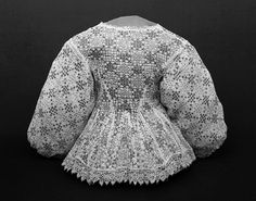 Jacket  Place of origin: England, Britain  Date:1630-1639  Materials and Techniques: Linen, linen thread, silver spangles, hand-sewn and hand-embroidered  Museum number:324-1903  Silver spangles (sequins) and drawn-thread and pulled-thread work adorn this woman's linen jacket.